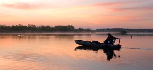 Fishing for bass at sunrise one morning in Alabama